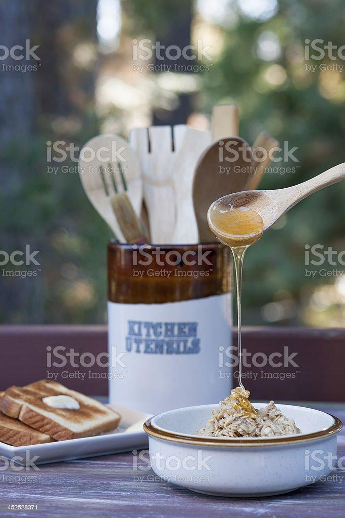 Honey on oatmeal. stock photo