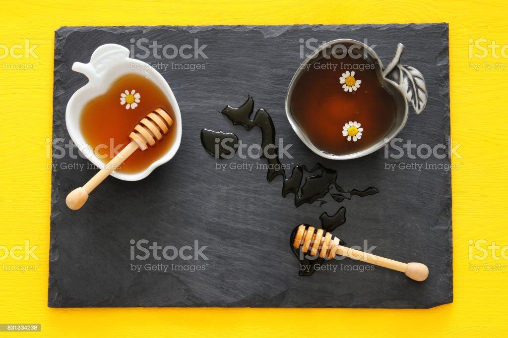 Honey on slate board. Rosh hashanah (jewish New Year holiday) concept stock photo