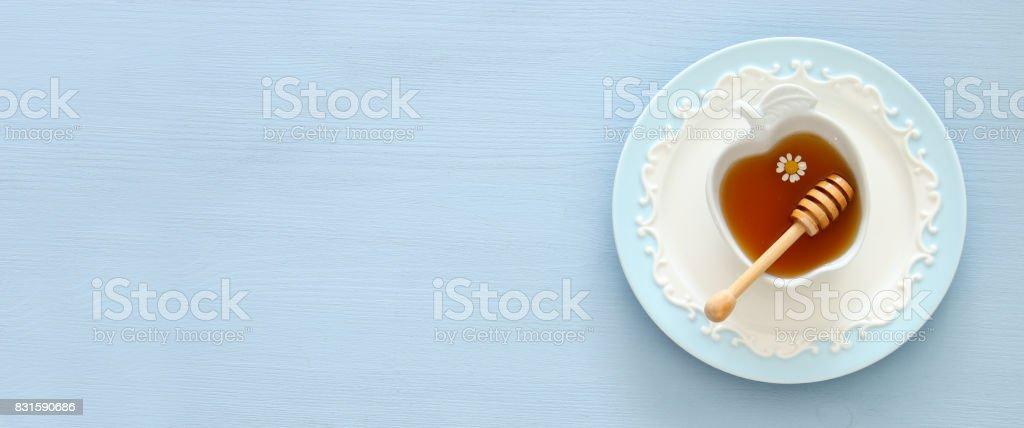 Honey on wooden background. Rosh hashanah (jewish New Year holiday) concept. Traditional symbol stock photo