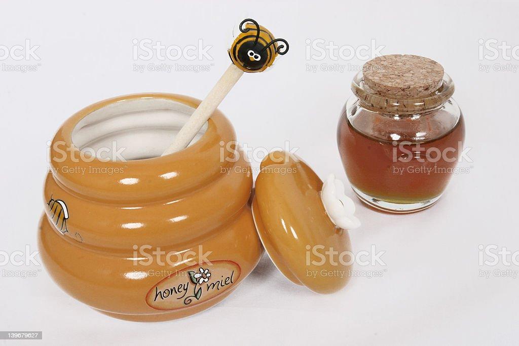Honey pot with some honey royalty-free stock photo