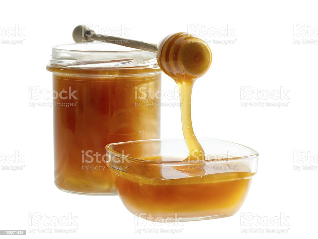 Honey Pouring From dripper Into The Bowl royalty-free stock photo