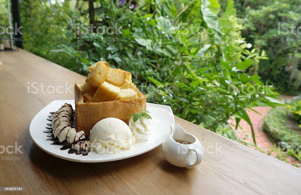 Honey toast bread with ice crame and banana stock photo