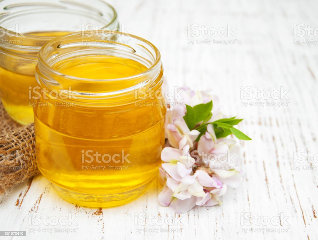 honey with acacia blossoms stock photo