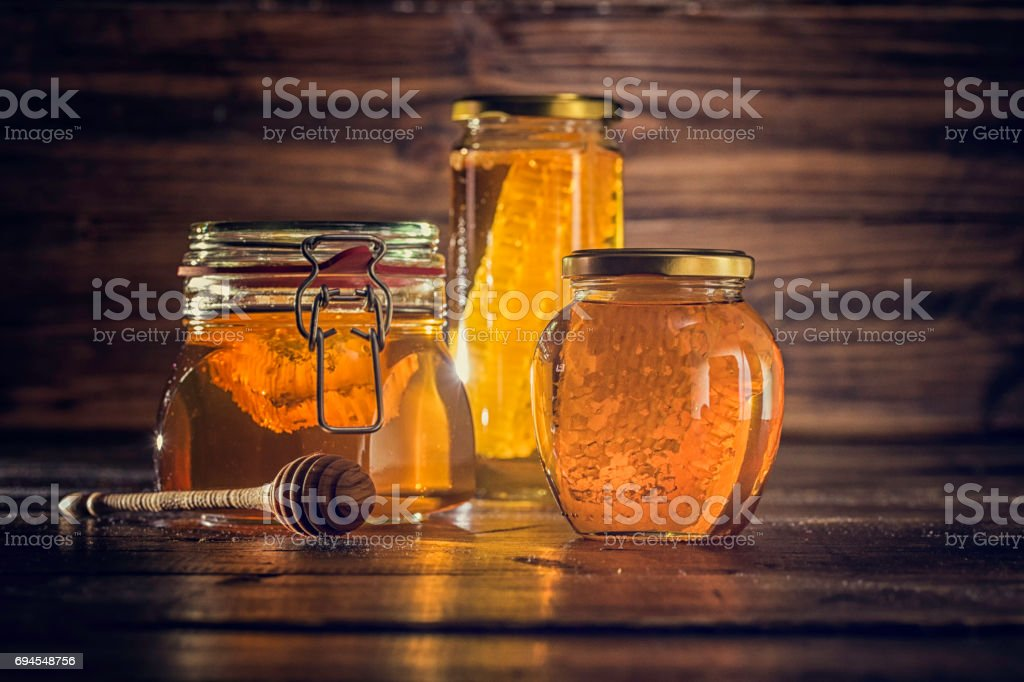 Honey with Honeycombs in a Jar stock photo