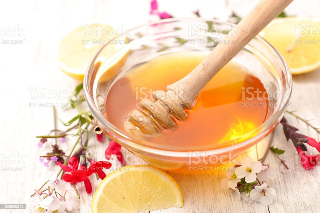 honey with wooden spoon stock photo
