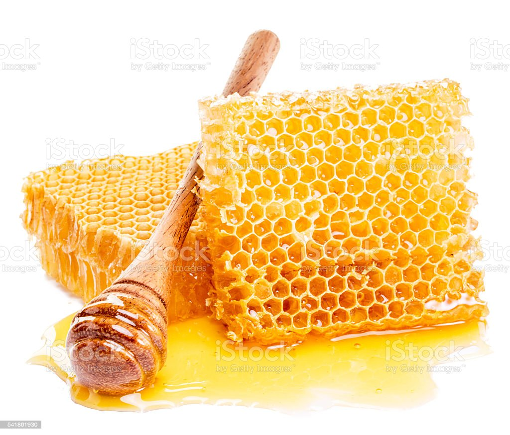 Honeycomb and honey drizzler. stock photo