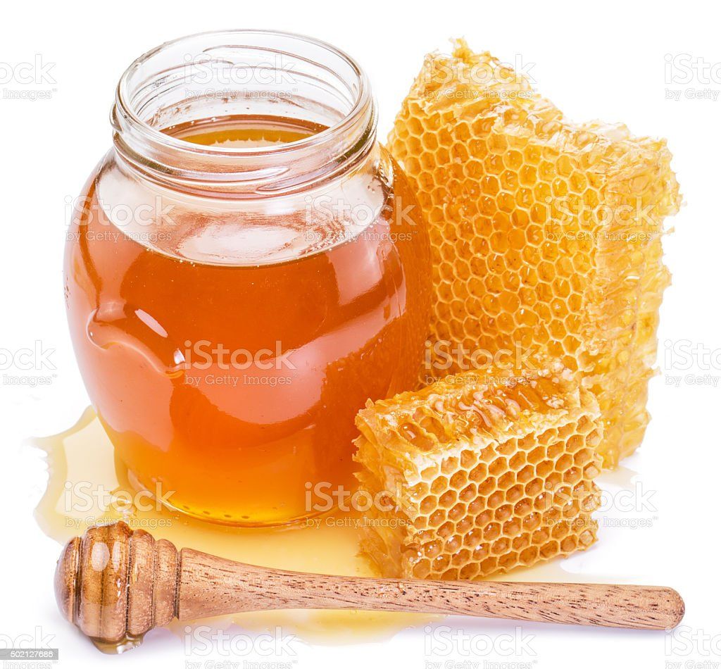 Honeycomb and pot of fresh honey. stock photo
