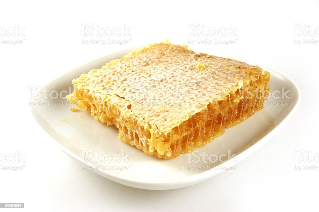 Honeycomb on a plate stock photo