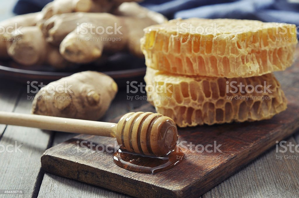 Honeycomb with fresh ginger stock photo