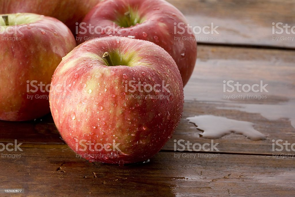 Honeycrisp apples on a wood background. stock photo