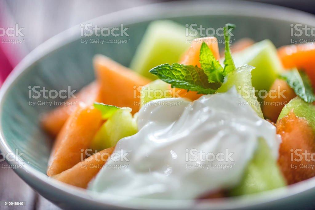 Honeydew and Cantaloupe Melon with Yogurt stock photo