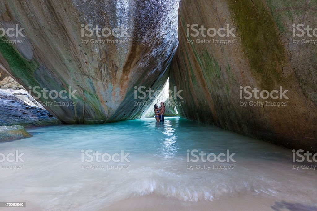 honeymoon couple hugging at The Baths, Virgin Gorda, BVI stock photo