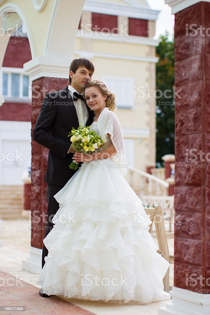 Honeymoon couple in love in the palace courtyard royalty-free stock photo