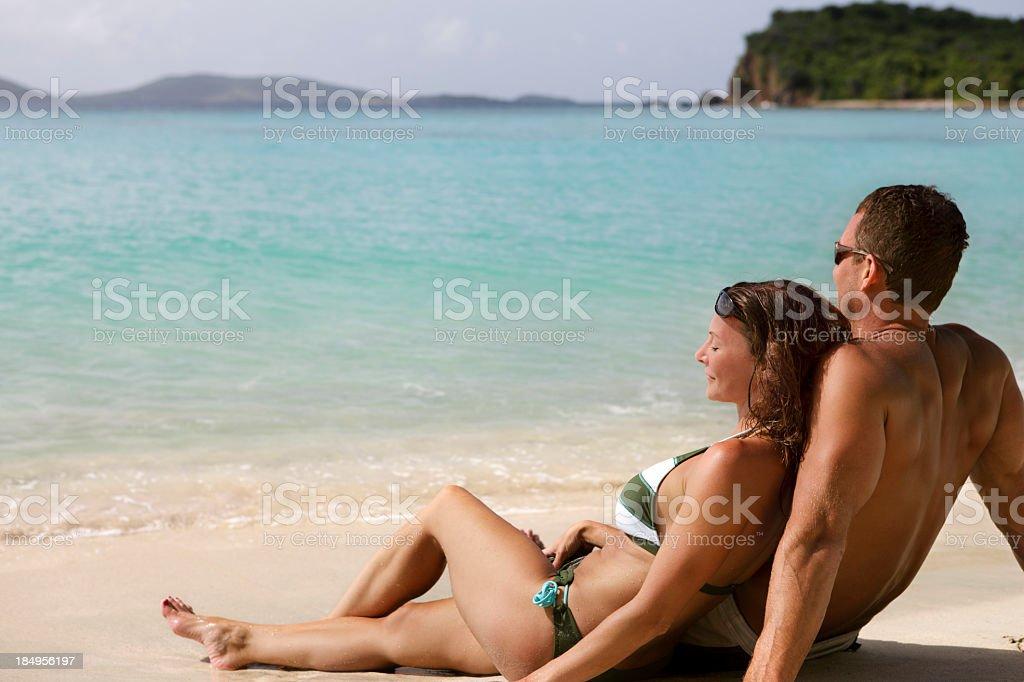 honeymoon couple on a tropical beach in the Caribbean royalty-free stock photo
