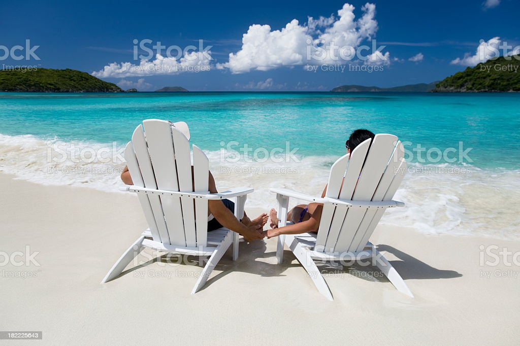 honeymoon couple relaxing in chairs at the beach royalty-free stock photo