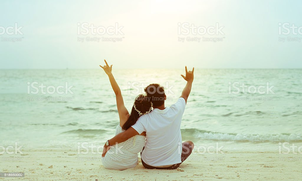 Honeymoon couple romantic on the island beach. sunset soft-focus backlit stock photo