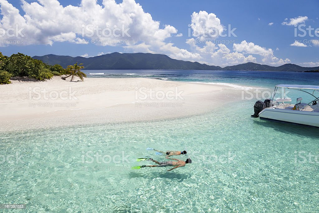 honeymoon couple snorkeling around a tropical island in the Caribbean royalty-free stock photo