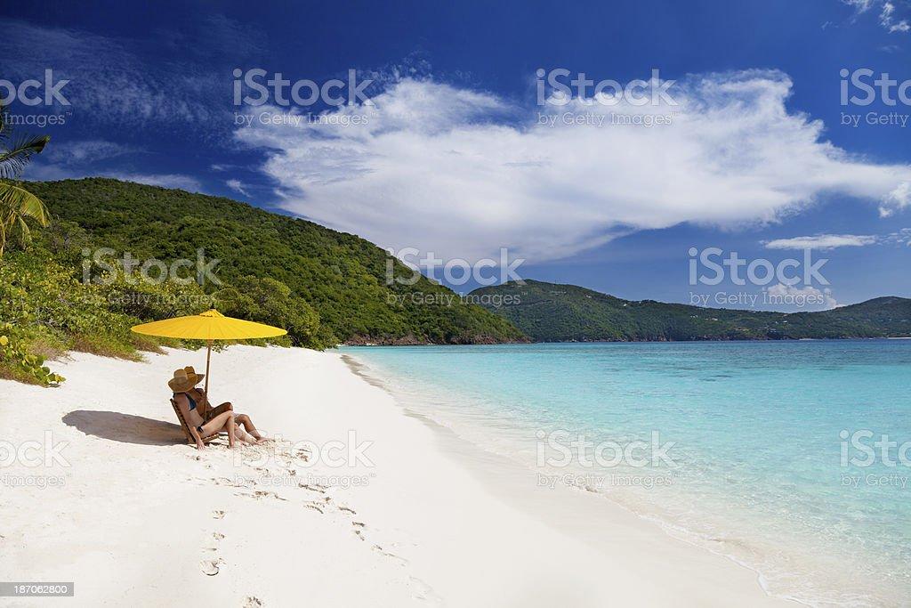 honeymoon couple sunbathing at a beach in the Caribbean royalty-free stock photo