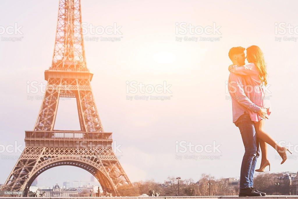 honeymoon in Paris, romantic love, happy couple near Eiffel tower stock photo