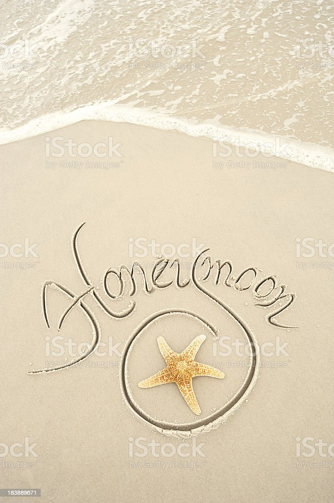 Honeymoon Message in Fancy Script on Clean Sand royalty-free stock photo