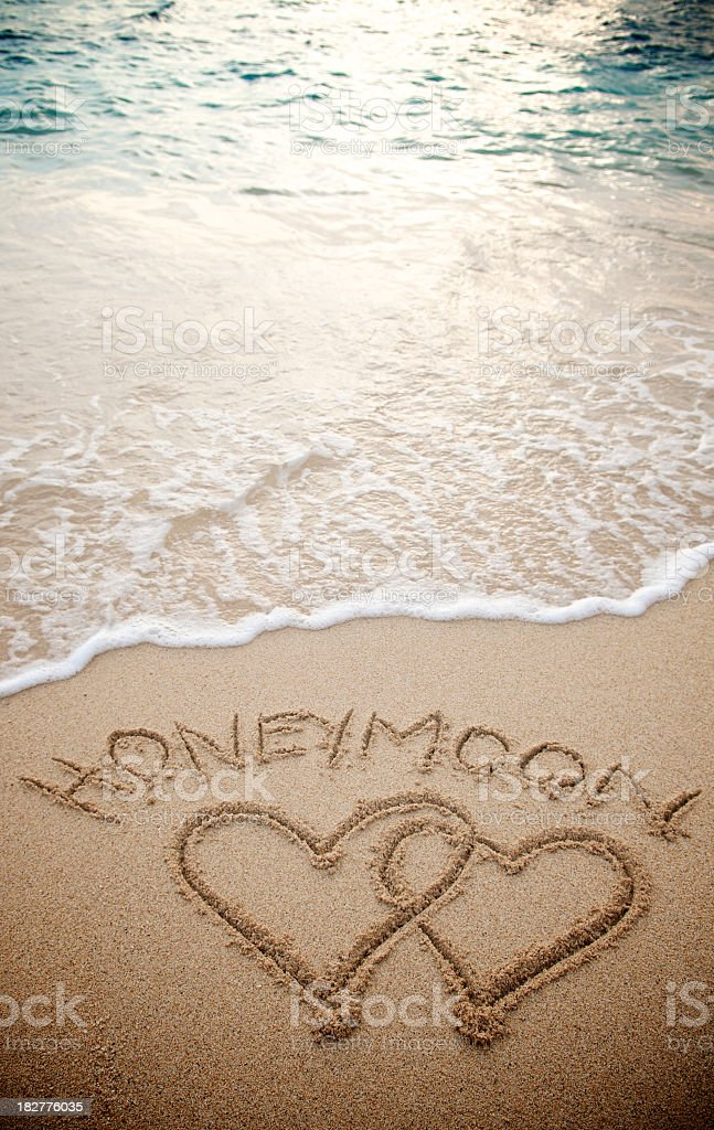 Honeymoon Two Hearts Couple on Textured Sand Tropical Beach stock photo