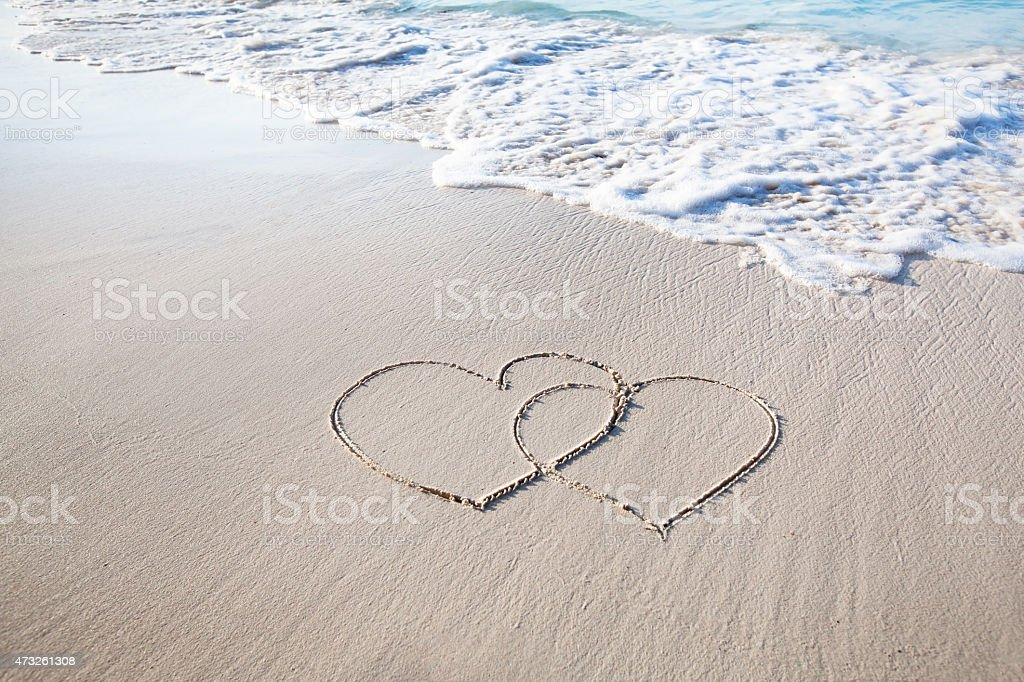 honeymoon, two hearts on the beach stock photo