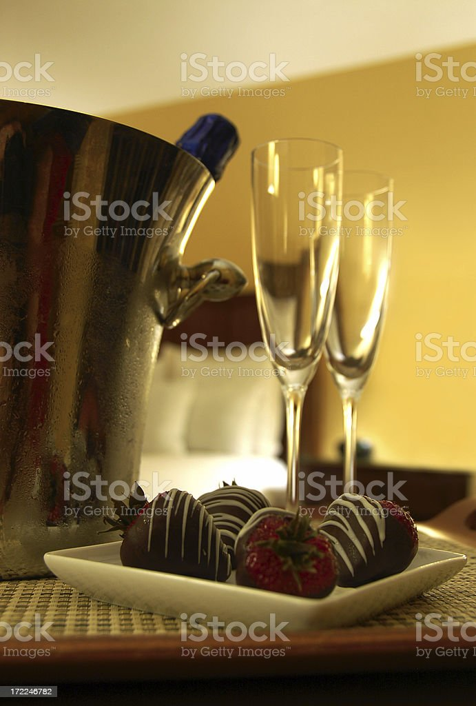 Honeymoon with champagne and chocolate dipped strawberries stock photo