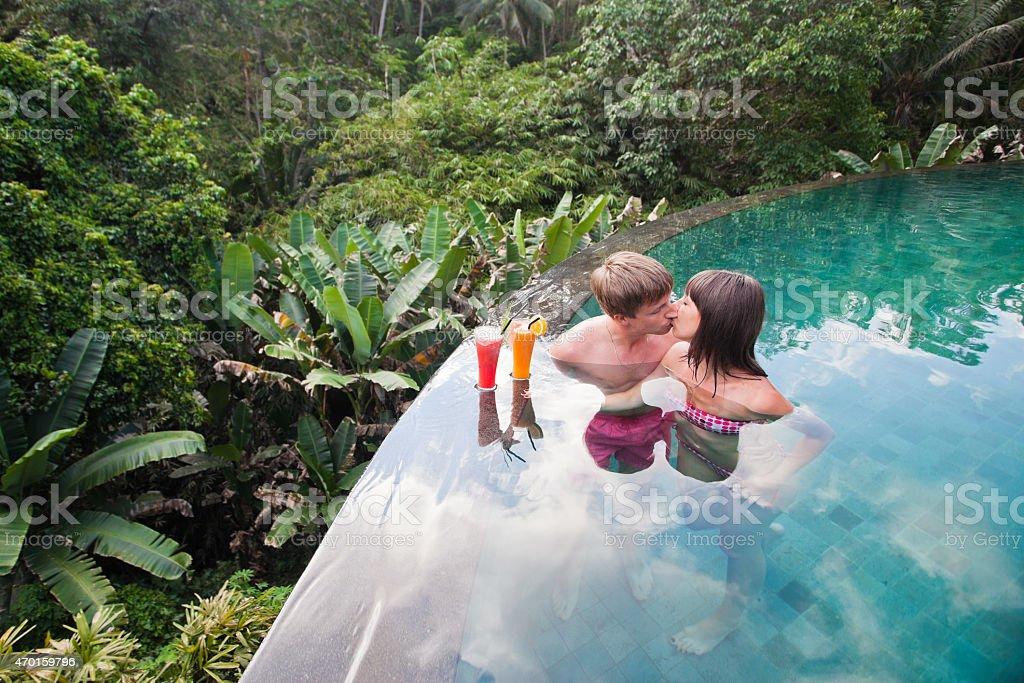 honeymooners couple at pool nea hotel stock photo