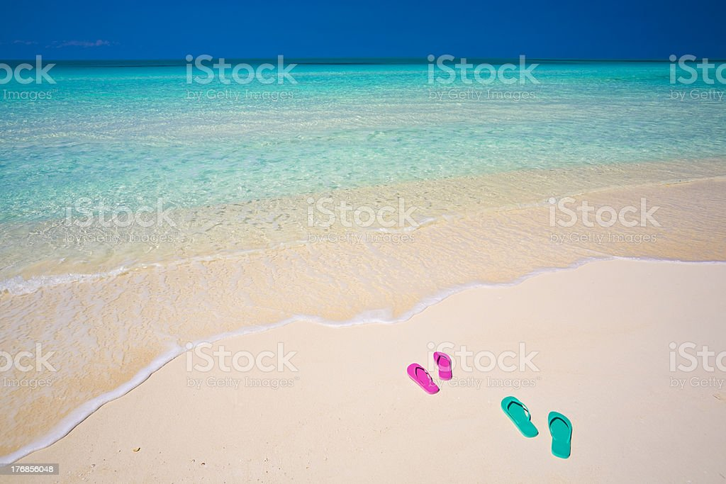 Honeymooners' thongs on pristine white sand beach royalty-free stock photo
