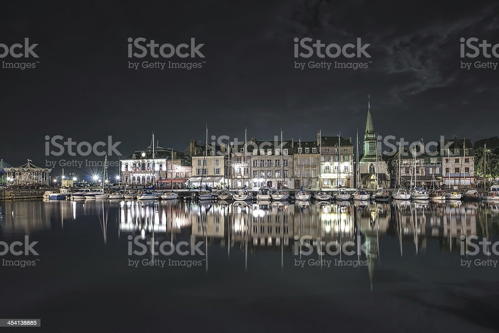 Honfleur night. Skyline port and water reflection. Normandy, France stock photo