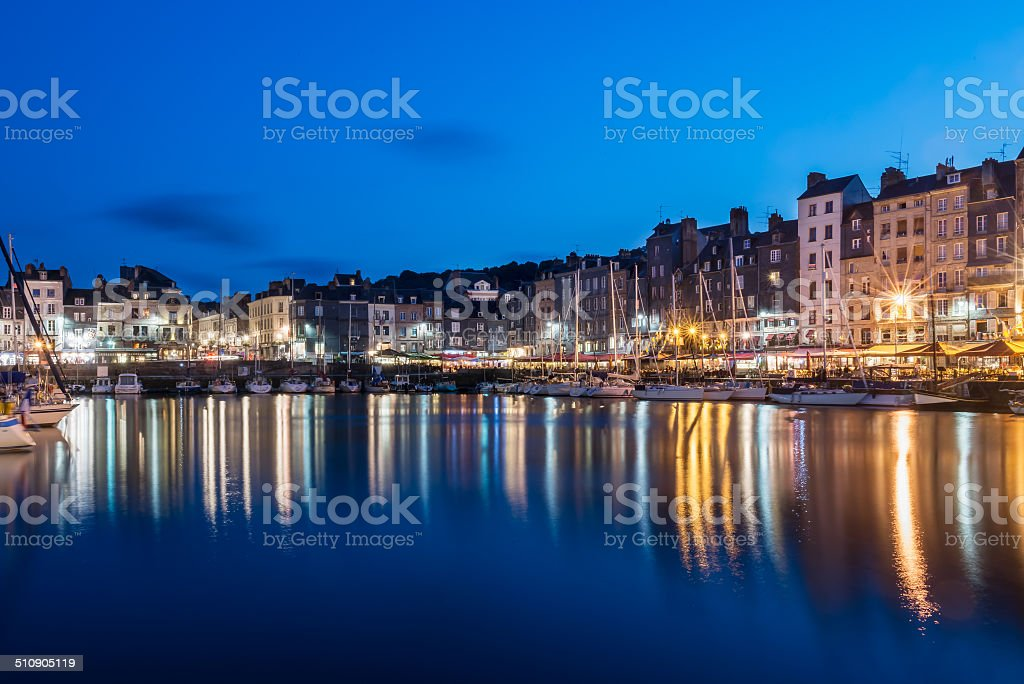 Honfleur Old Harbor by night, Normandy, France stock photo