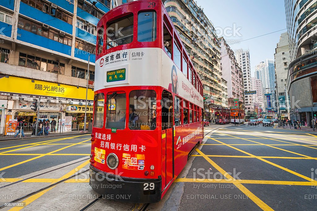 Hong Kong colourful red tram in busy city streets China stock photo