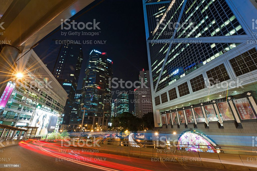 Hong Kong downtown skyscrapers illuminated zooming traffic neon night China stock photo