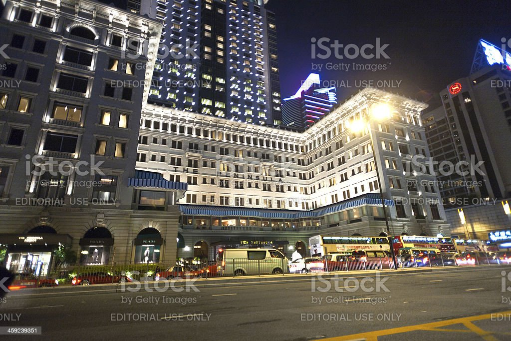 Hong Kong famous luxury Hotel Peninsula by night stock photo