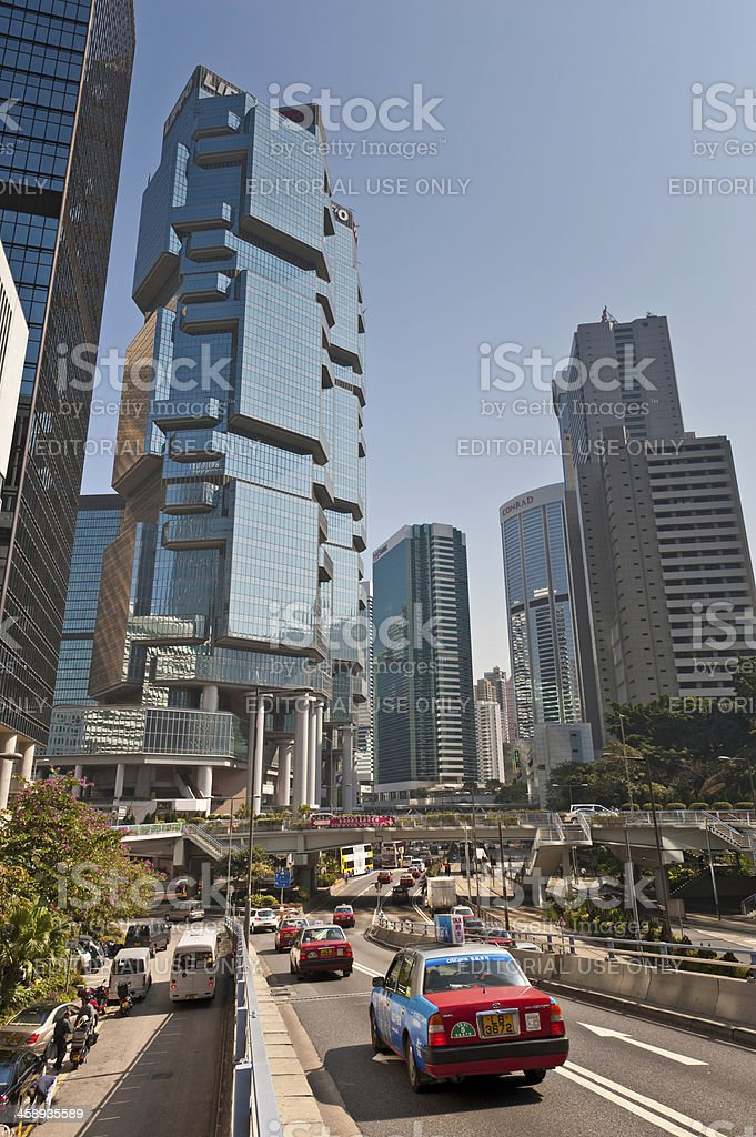 Hong Kong financial district skyscrapers and taxis royalty-free stock photo