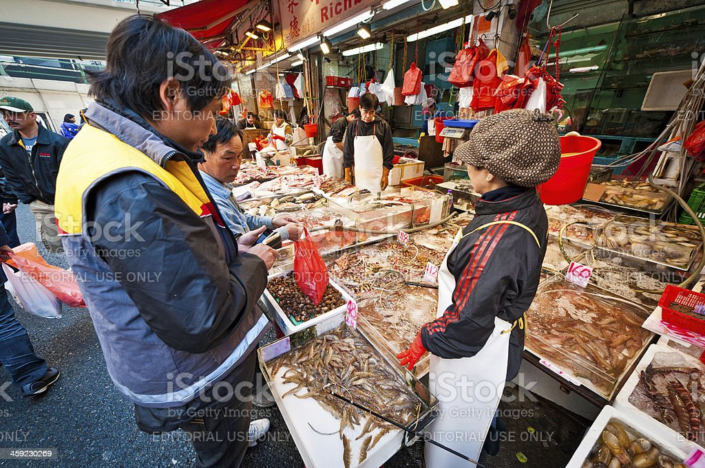 Hong Kong fish market street stall Chinese shoppers royalty-free stock photo