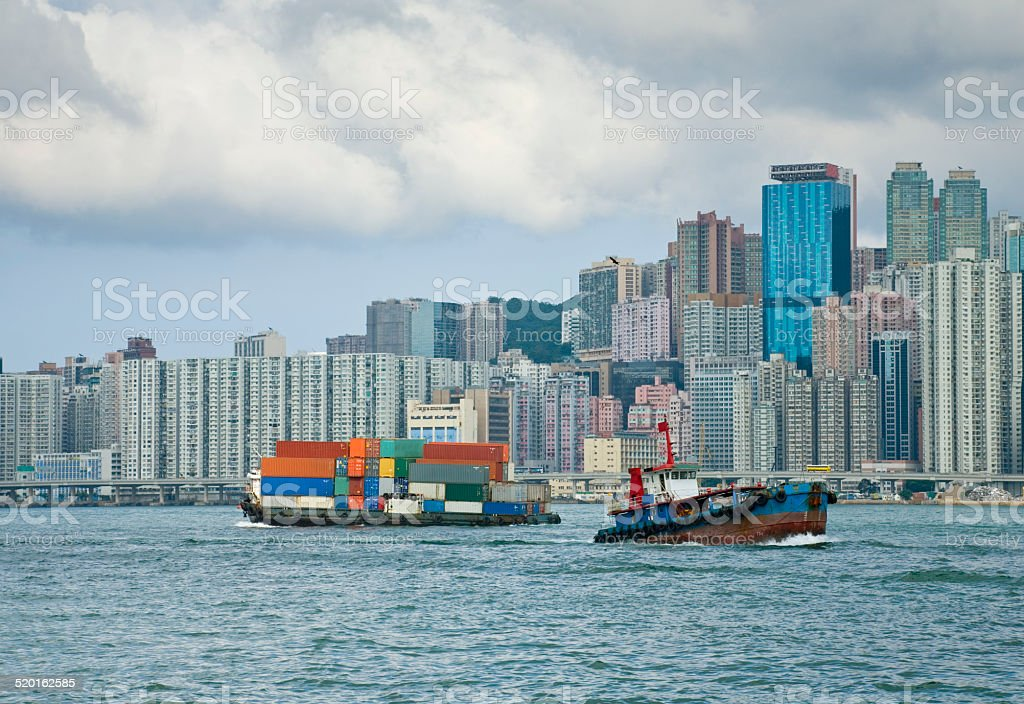 Hong Kong Harbor with Heavily Laden Lighter stock photo
