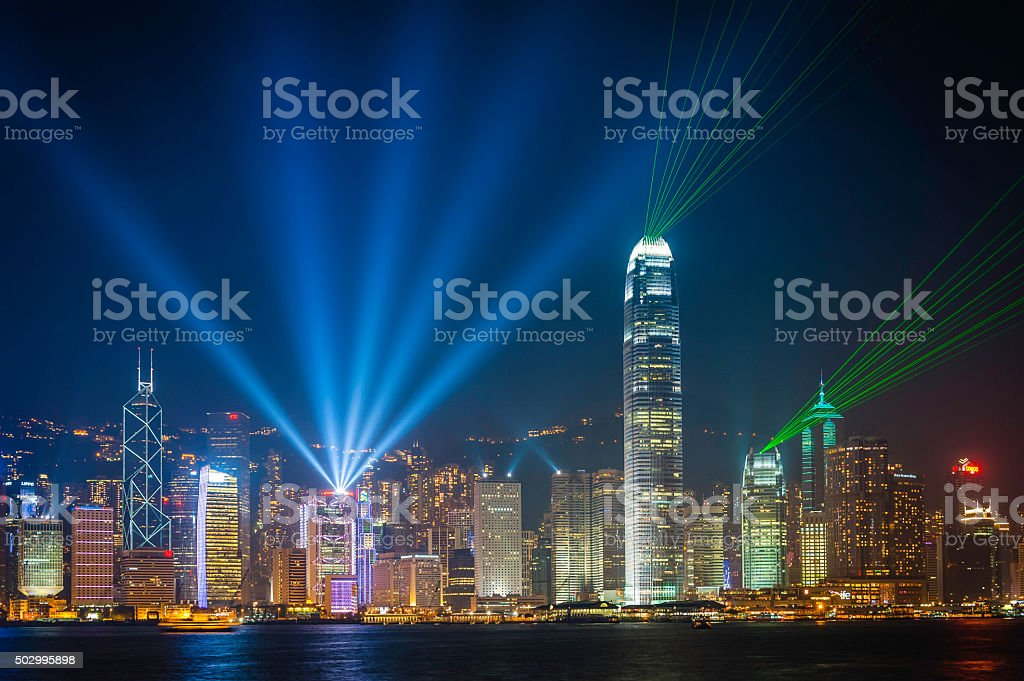 Hong Kong harbour laser light show from futuristic skyscrapers China stock photo