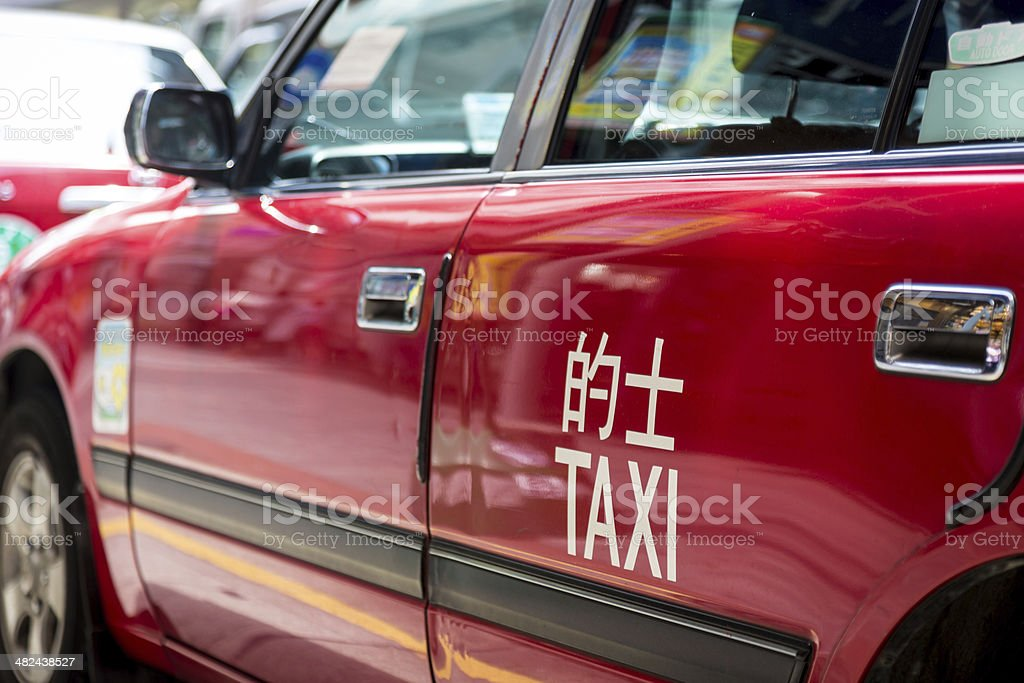 Hong Kong Red Taxi Cab In Busy Street stock photo