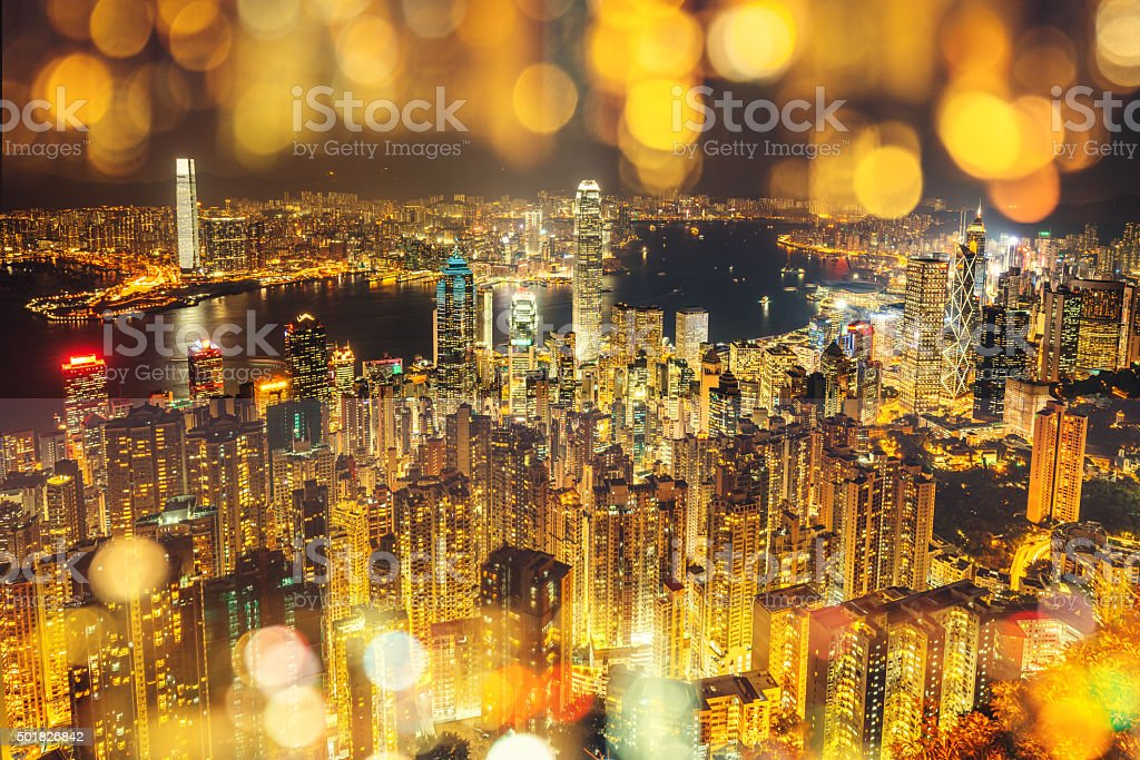 Hong Kong skyline at night with light effects stock photo