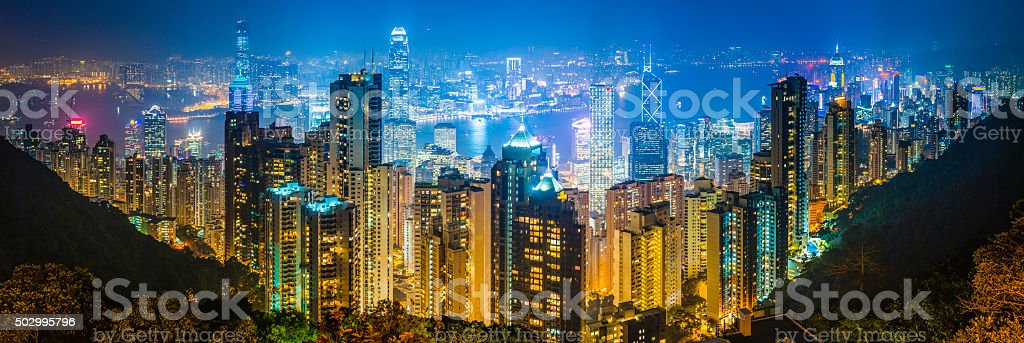 Hong Kong skyscrapers highrise apartments illuminated harbour cityscape panorama China stock photo