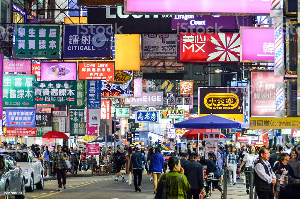 Hong Kong street scene with neon signs at night stock photo