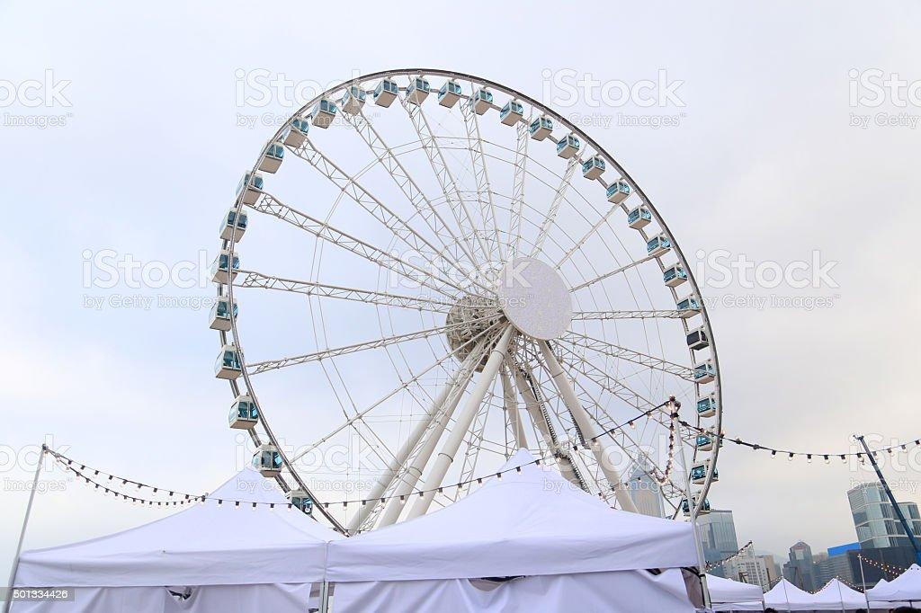 hong kong white ferris wheel stock photo