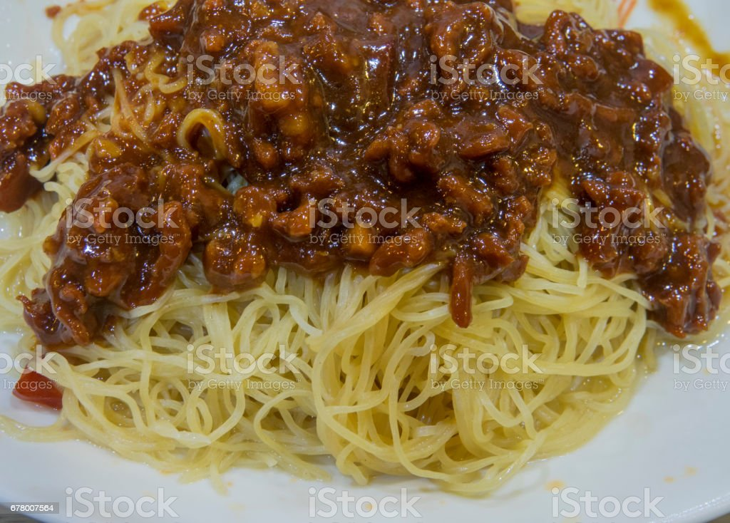 Hong Kong-style dry noodles with minced pork and spicy soy sauce stock photo