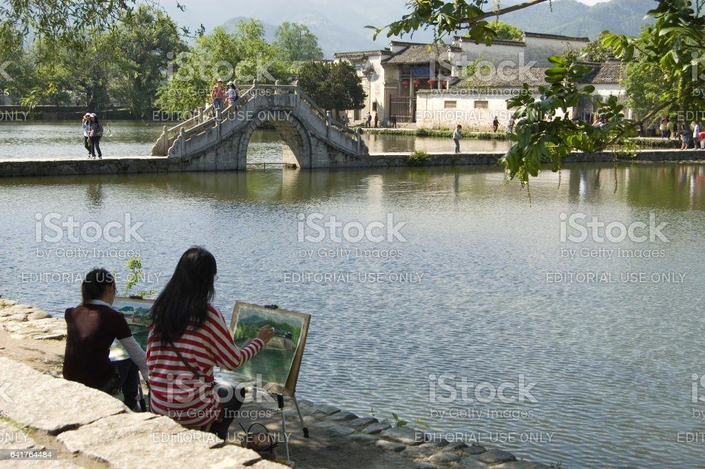 Hongcun bridge and artists stock photo