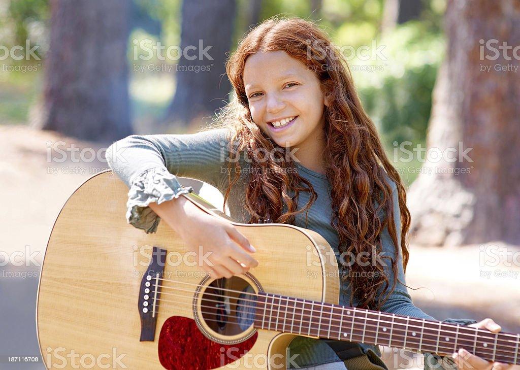 Honing her guitar skills royalty-free stock photo