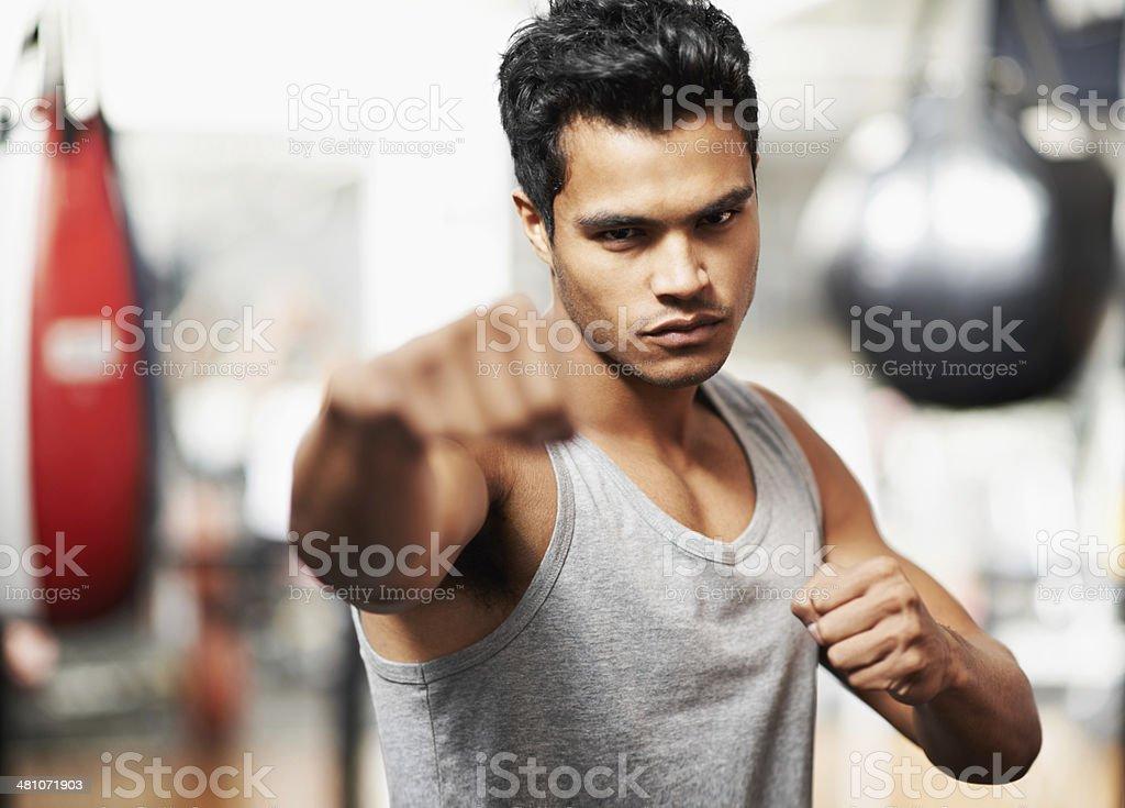 Honing his fighting skills stock photo
