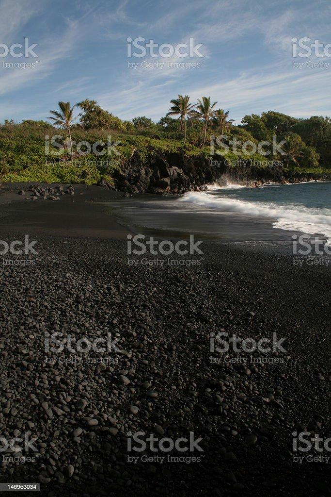 Honokalani Black Sand Beach, Wainapanapa State Park, Maui stock photo