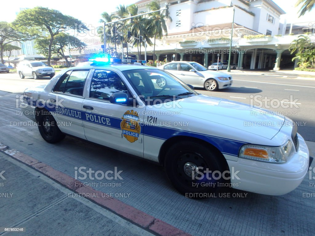 Honolulu Police Department police car lights flash on Ala Moana Boulevard stock photo