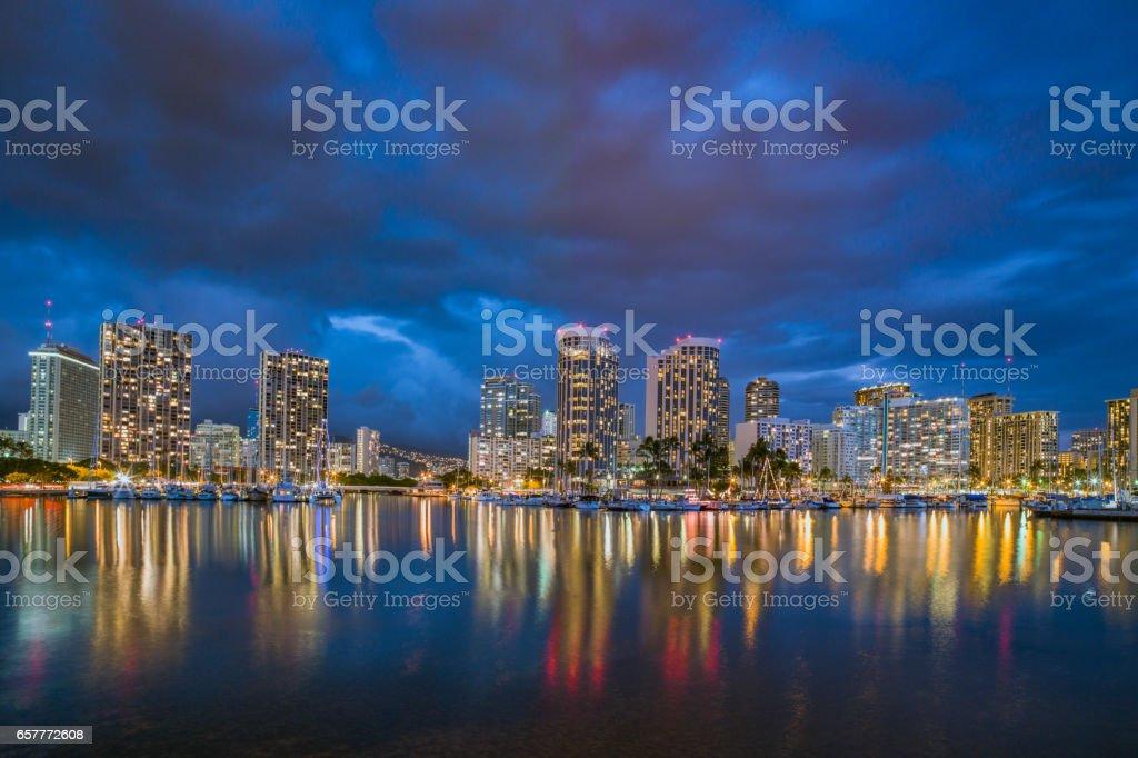 Honolulu Skyline at Night Ala Wai Waikiki Oahu Hawaii stock photo
